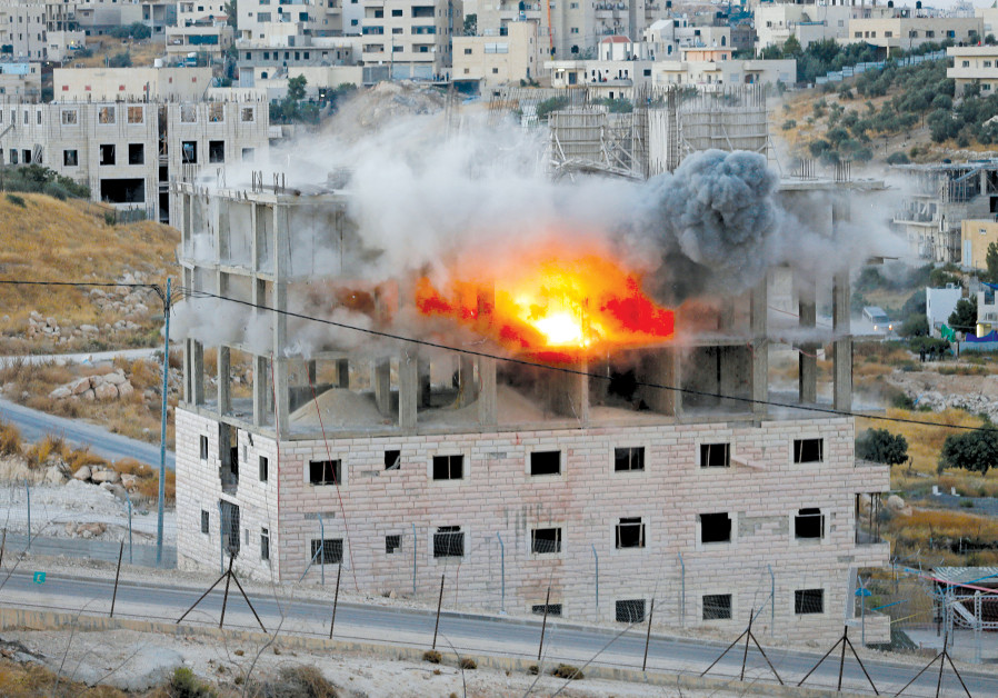 A BUILDING IS blown up by Israeli forces in the village of Sur Bahir last week