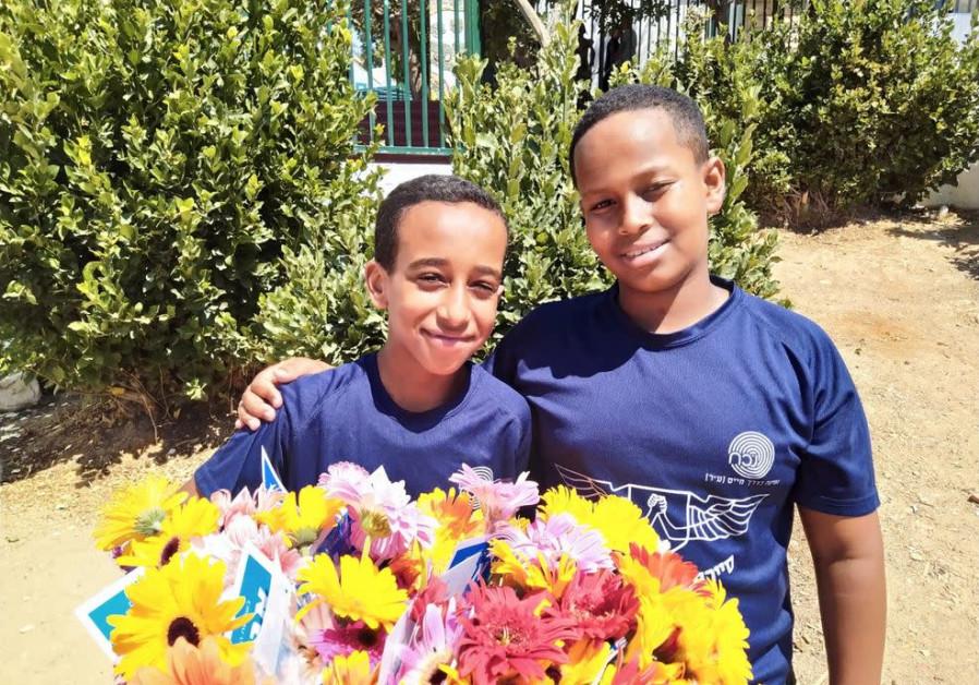 SAHI volunteers hand out flowers in memory of Solomon Tekah