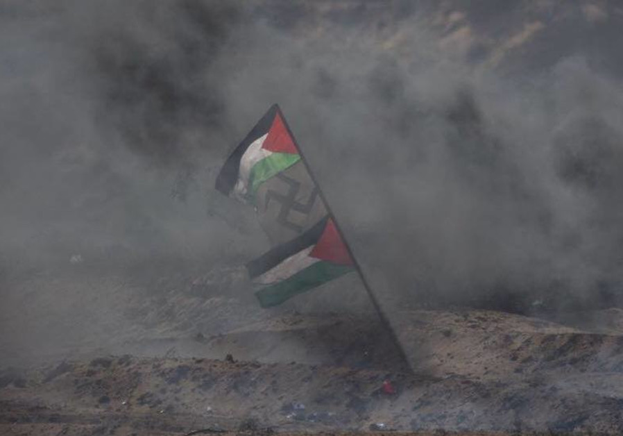 Swastika hung next to Palestinian flag on Gaza border fence during March of Return June, 2018