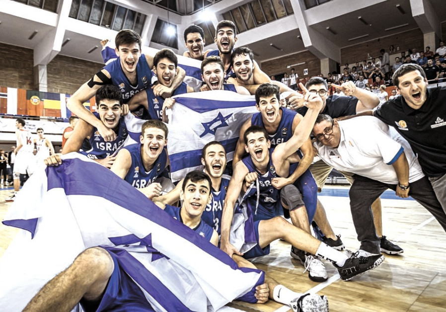 ISRAEL'S UNDER-18 national basketball team celebrates on the court after defeating Poland 81-79 in t