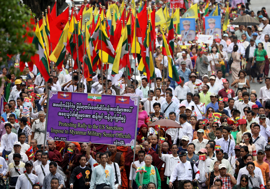 Pro-military demonstrators march to protest the U.S. sanctions imposed on Senior General Min Aung Hl