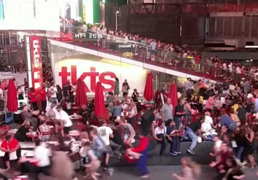 Stampede in New York City's Times Square as people confuse motorcycle with gunshots