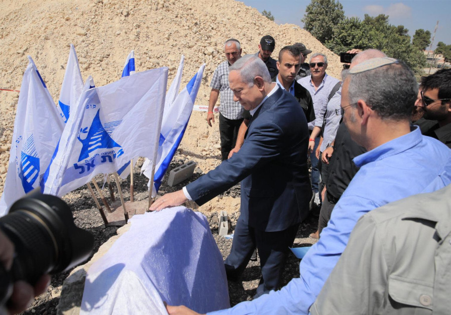 Prime Minister Benjamin Netanyahu visits the Beit El settlement hours after the body of terror victi