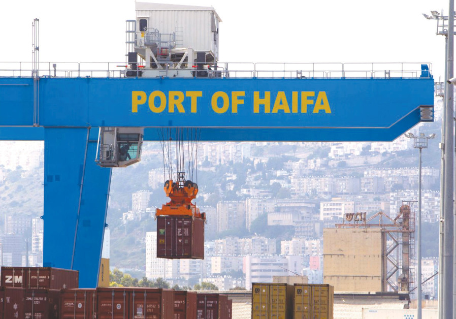 A CRANE unloads a container at the Port of Haifa