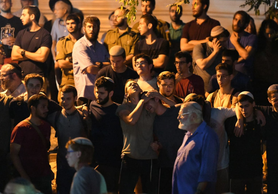 Teenagers mourn at the funeral of 19-year-old Dvir Sorek, who was killed in a terror attack.