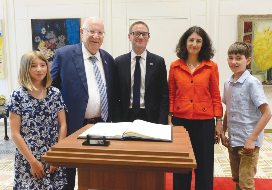 PRESIDENT REUVEN RIVLIN greets UK Ambassador Neil Wigan and his family at the President's Residence