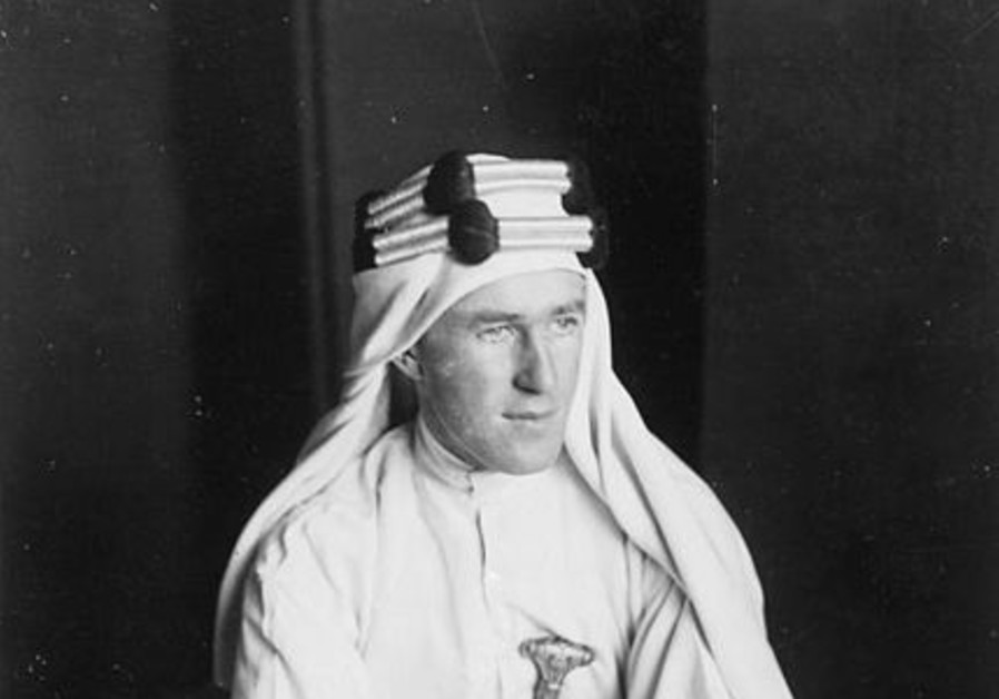 T E Lawrence 1888-1935 Lawrence in Arab dress seated on the ground