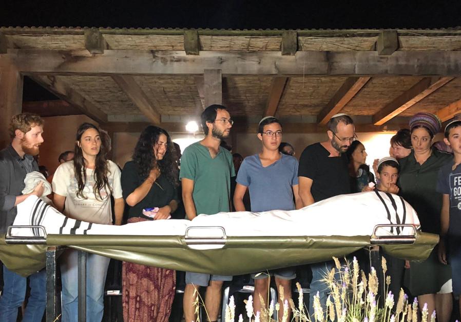 The Sorek family buries Dvir Sorek, 19.