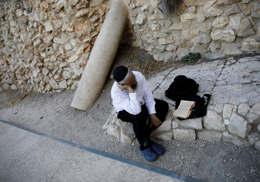 ewish worshipper prays next to a pillar that Israeli archeaologists say formed part of the Second Te