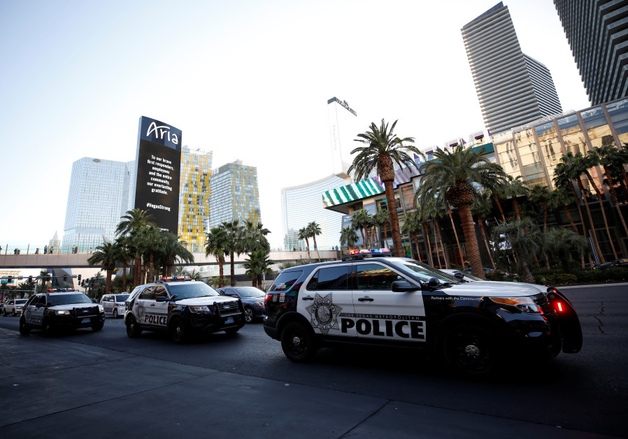Police vehicles line Las Vegas Boulevard following the mass shooting, October 4, 2017.