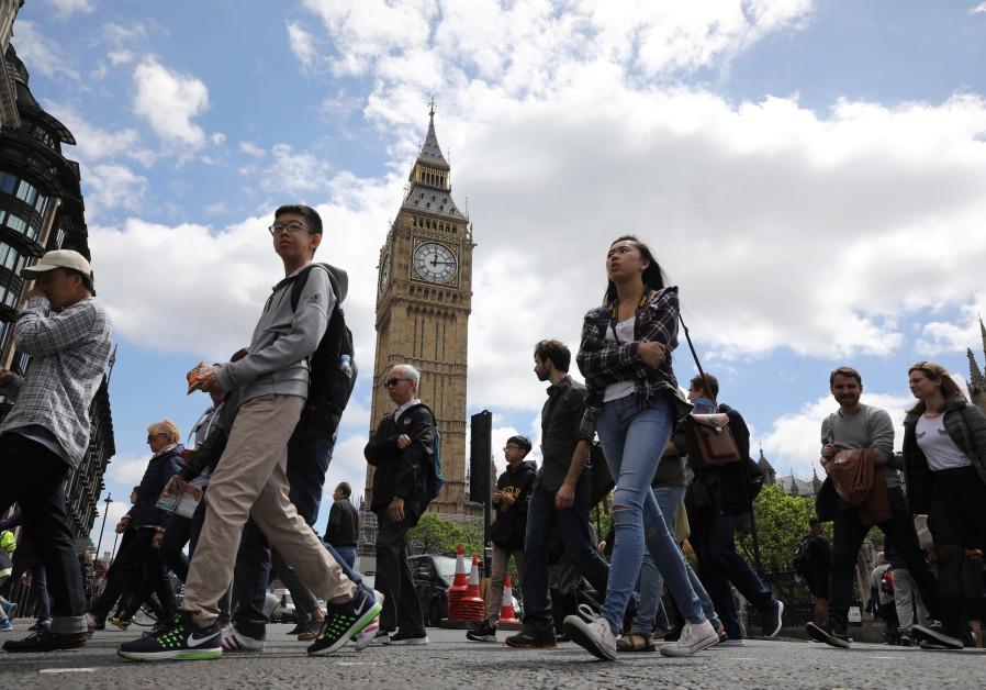 Tourists walk past Big Ben in Westminster