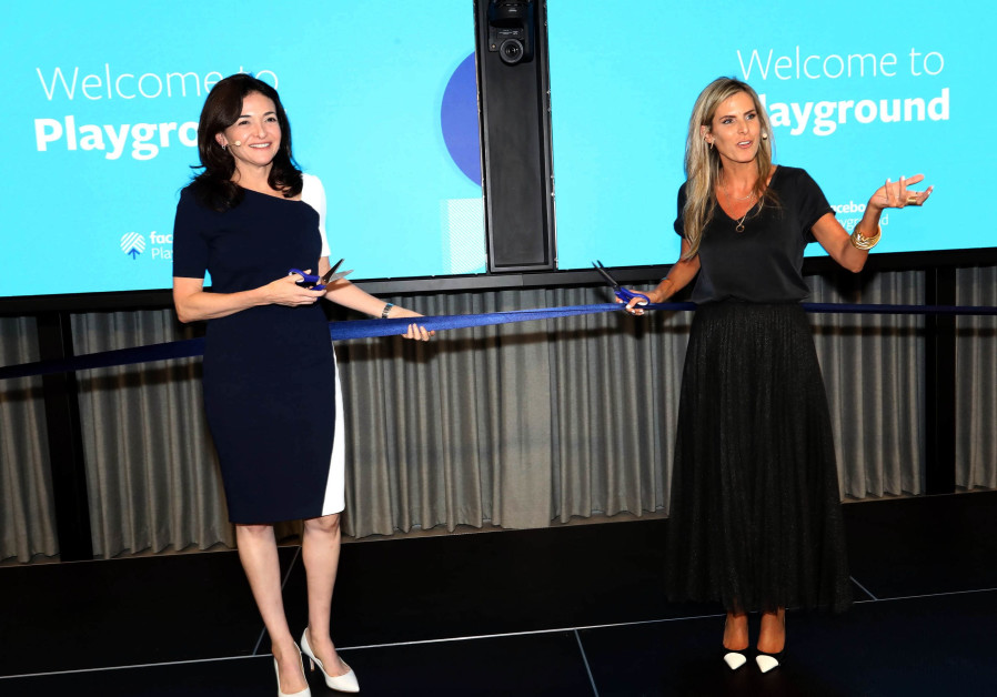 Facebook COO Sheryl Sandberg (L) and Facebook Israel general manager Adi Soffer Teeni (R) inaugurate