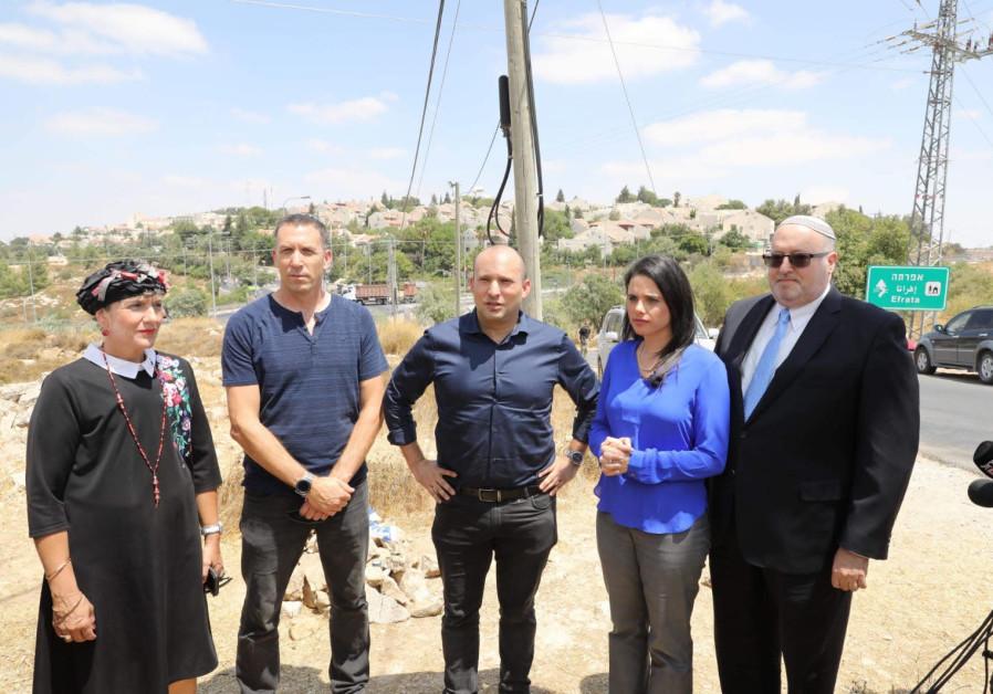 New Right leaders Naftali Bennett and Ayelet Shaked at the sight where a terrorist killed Dvir Sorek