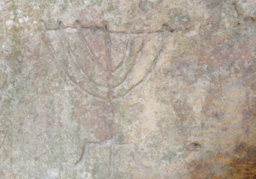 Menorah carved in ancient catacombs