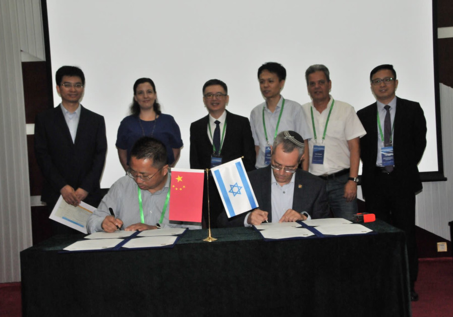 Prof. Yuliang Zhao (L) and Prof. Dror Fixler (R) sign an agreement to establish a Chinese Academy of