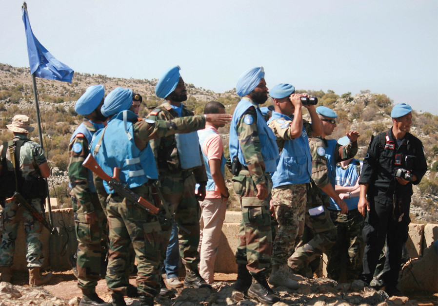 LEBANESE SOLDIERS and UN peacekeepers (blue berets and turbans) serving with UNIFIL inspect areas targeted by IDF shelling in the Shebaa area, southern Lebanon, on October 8, 2014. (Credit:REUTERS/KARAMALLAH DAHER)