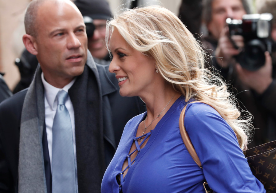 Adult-film actress Stephanie Clifford, also known as Stormy Daniels, arrives with her attorney Micha