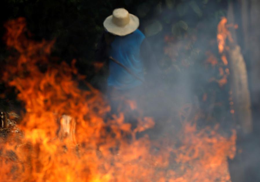 As record numbers of fires burn in Amazon, Bolsonaro blames NGOs