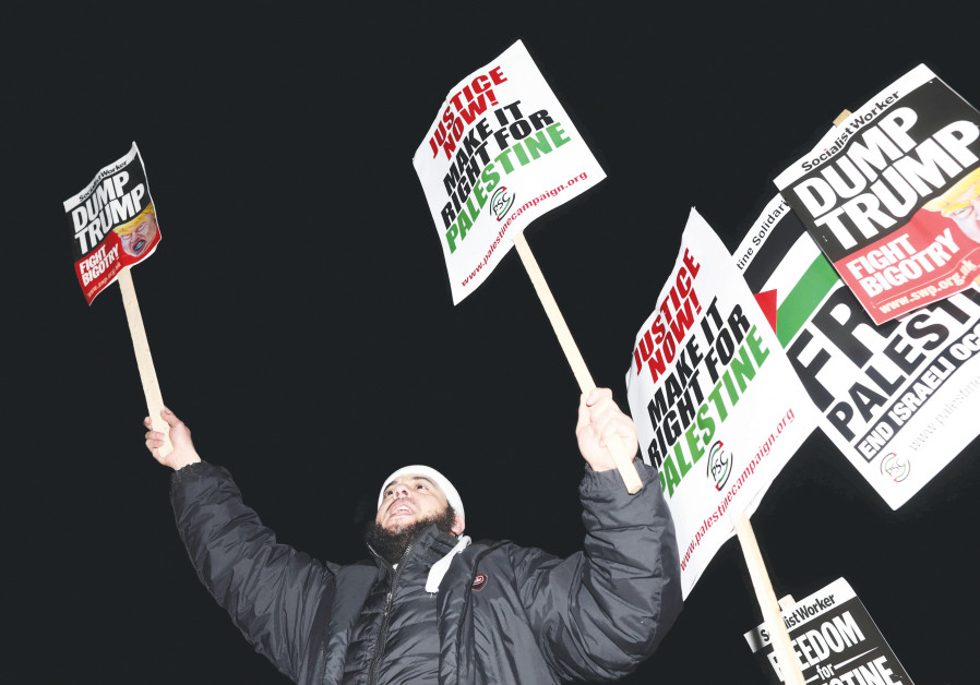 PROTESTERS IN London shout anti-Israel slogans.