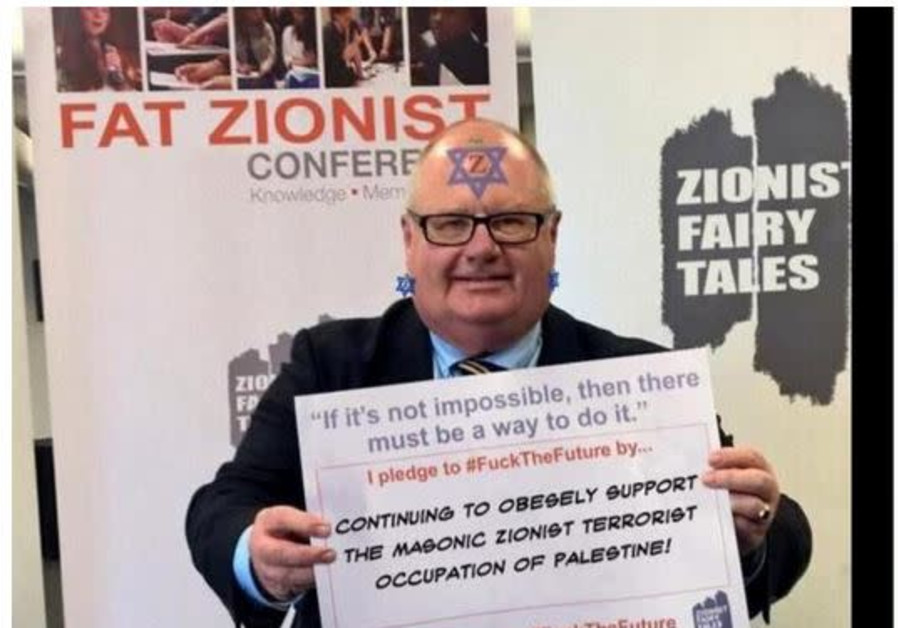 Edited image of Eric Pickles holding up a pledge to remember the Holocaust at a Holocaust Educational Trust event (Credit: Facebook)