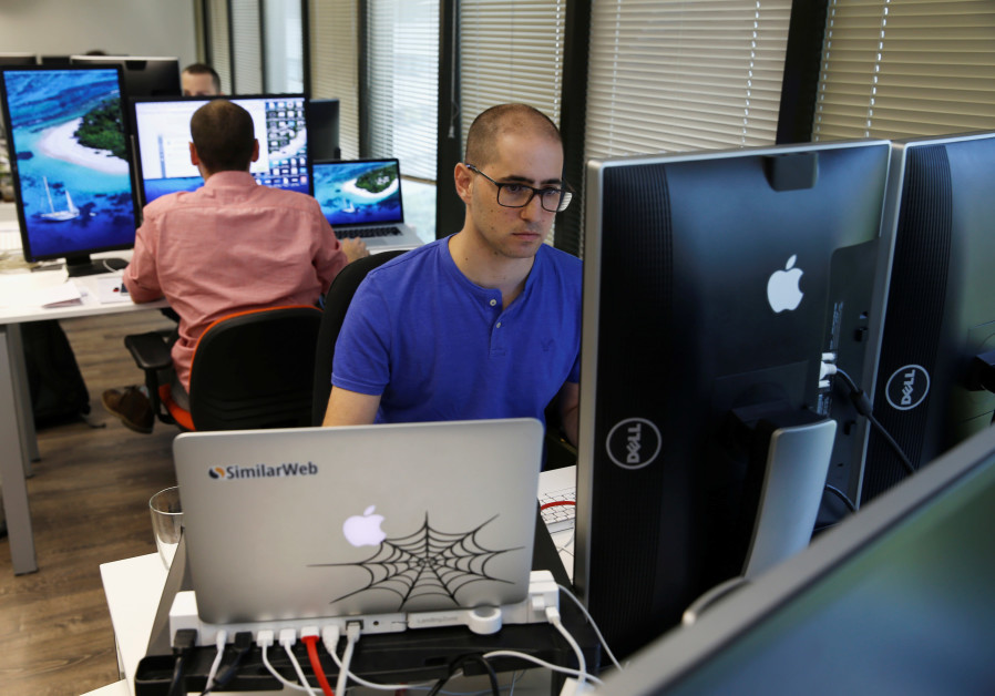 An employee works at Internet data firm SimilarWeb at their offices in Tel Aviv, Israel July 4, 2016