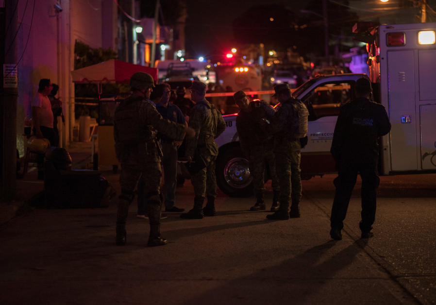 At least 23 killed in suspected attack on bar in Mexico
