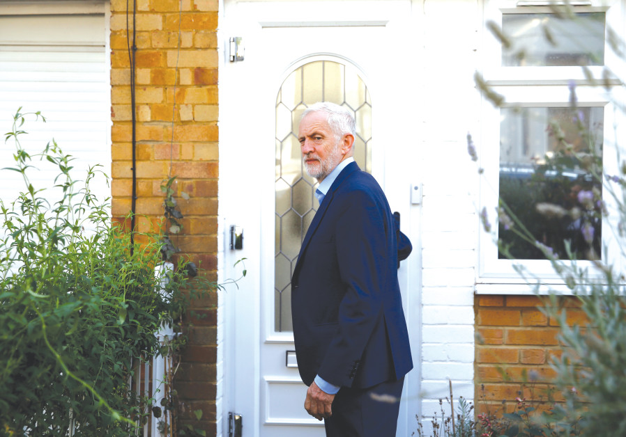 BRITAIN'S OPPOSITION Labour Party leader Jeremy Corbyn leaves his home in London yesterday.
