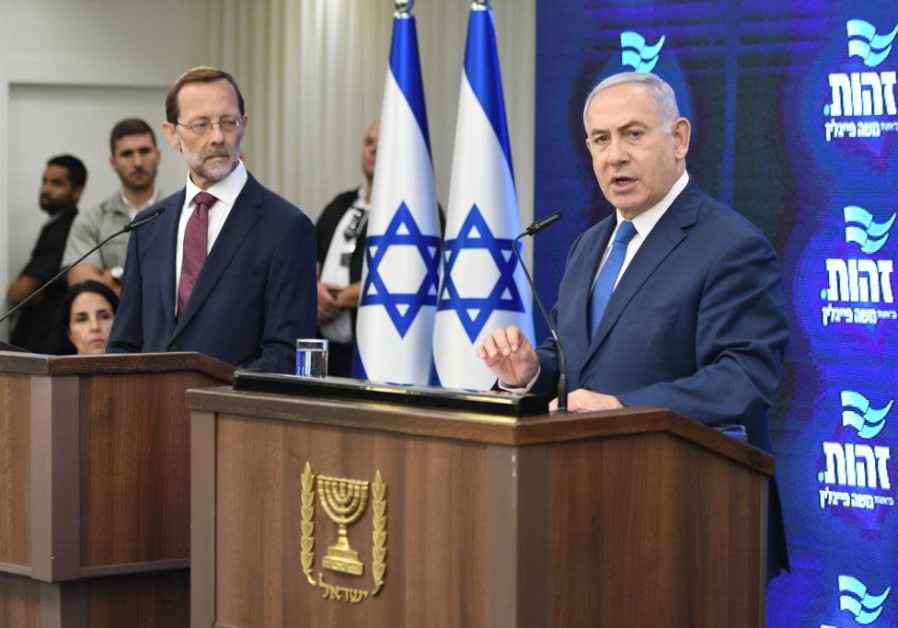 Prime Minister Benjamin Netanyahu and Zehut party leader Moshe Feiglin hold a press conference.