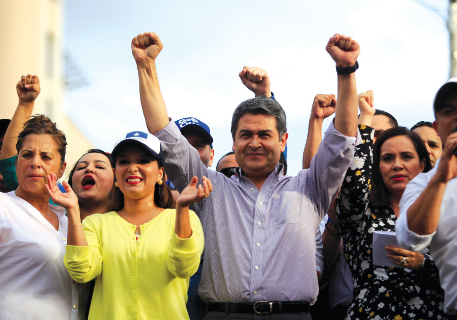 HONDURAN PRESIDENT Juan Orlando Hernández rallies with supporters outside the Presidential House.