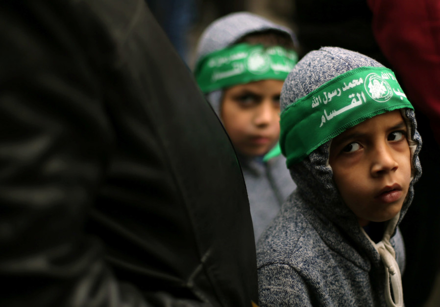 Palestinian children wearing Hamas headbands take part in a rally against US President Donald Trump
