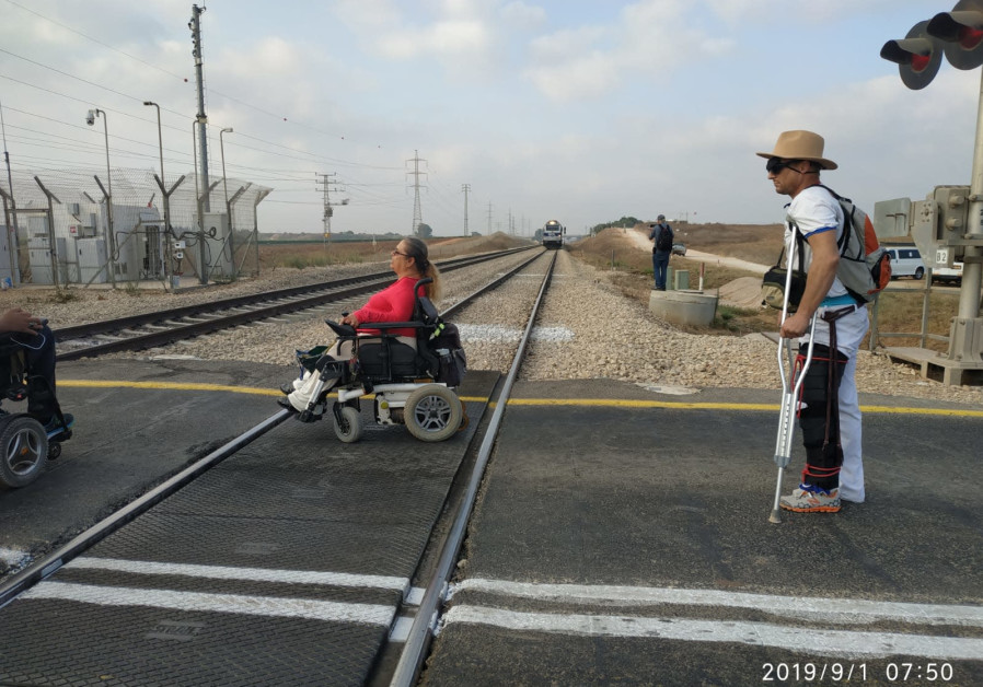Dozens of disabled Israelis blocked train station, traffic in protests