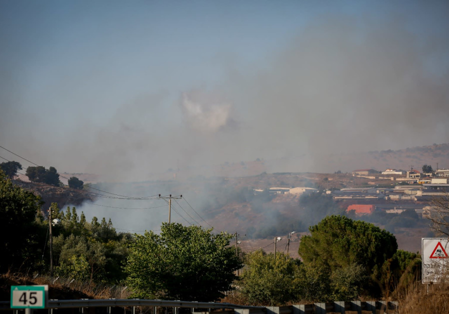 Smoke rises near Moshav Avivim near the border between Israel and Lebanon, in northern Israel, Septe