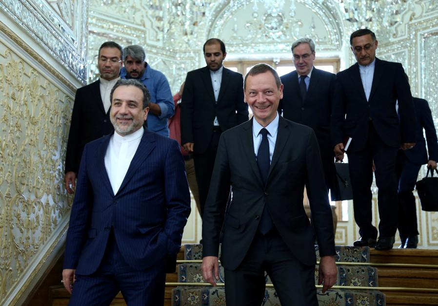 Iran's deputy foreign minister, Abbas Araqchi (L), with visiting senior French diplomat Emmanuel Bo