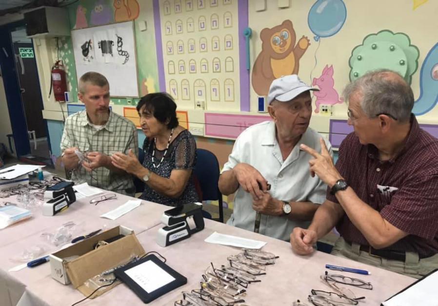 Helping Hand Coalition distributes eyeglasses to Holocaust survivors