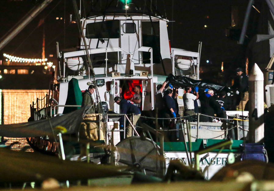 Rescue personnel return to shore with the victims of a pre-dawn fire that sank a commercial diving b