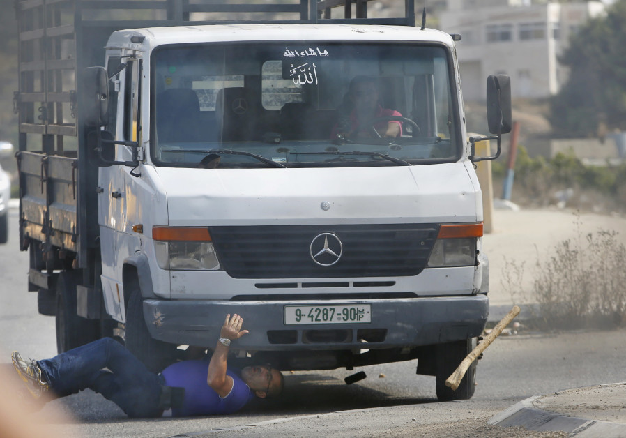 A Palestinian vehicle rams into Israeli Avraham Hasno, who died later, in Hebron
