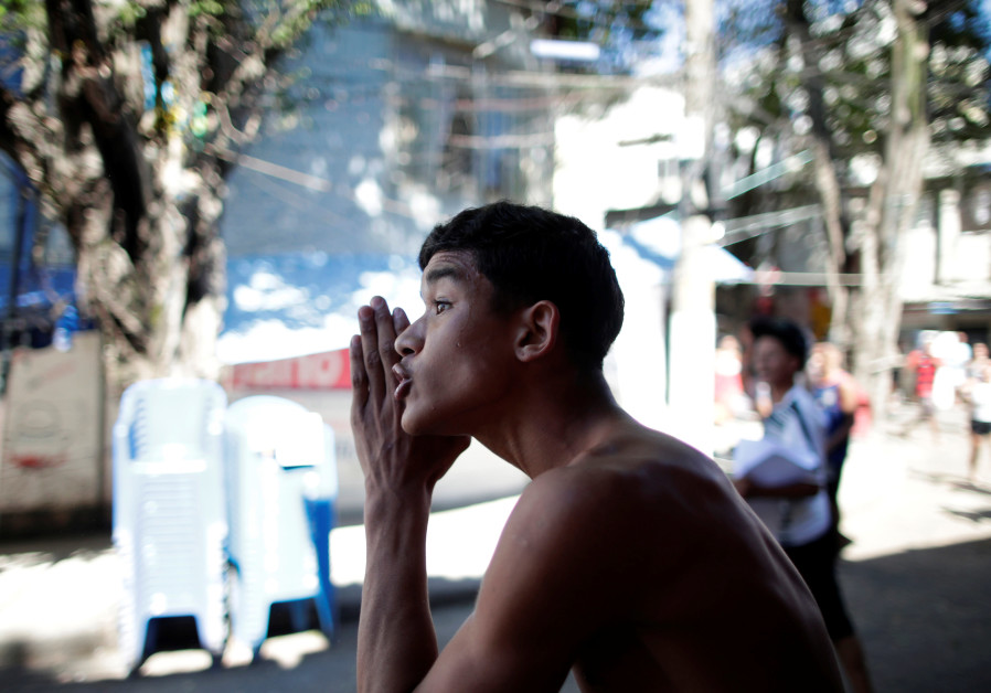 Resident of Borel favela shouts during a protest against the death of a young man, Rio de Janeiro.