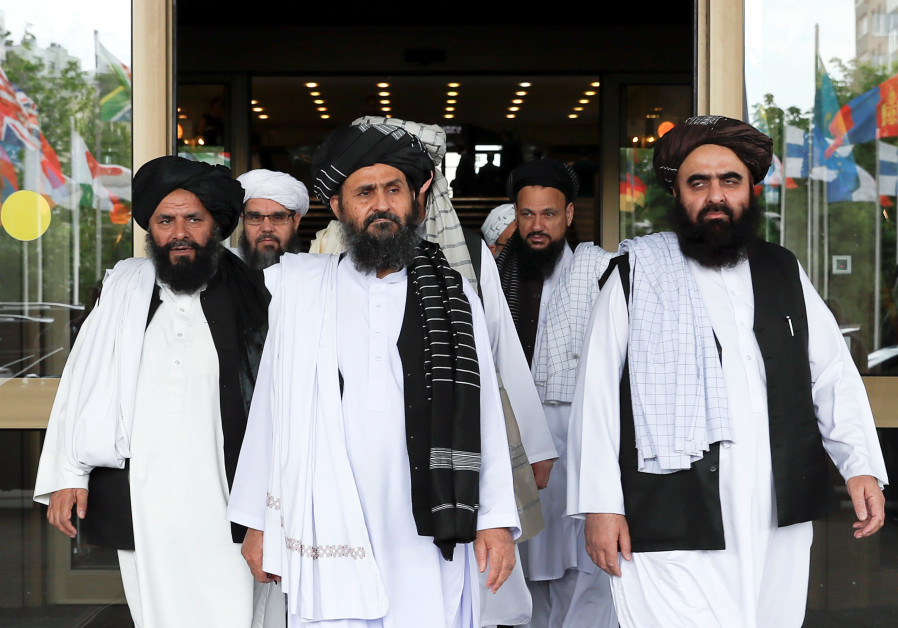Members of a Taliban delegation leave after peace talks with Afghan politicians in Moscow, May, 2019
