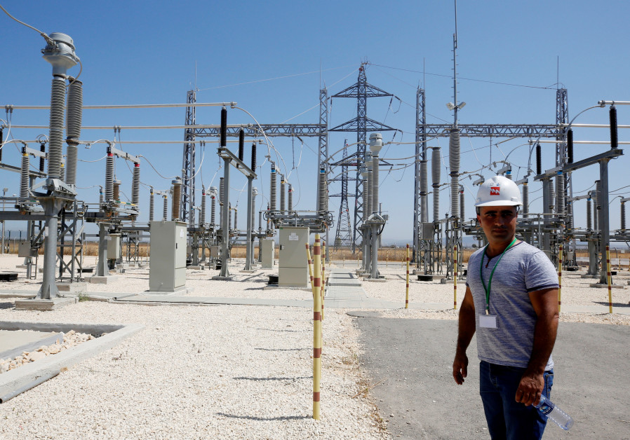 Israeli engineer stands in the new electrical substation near the West Bank city of Jenin