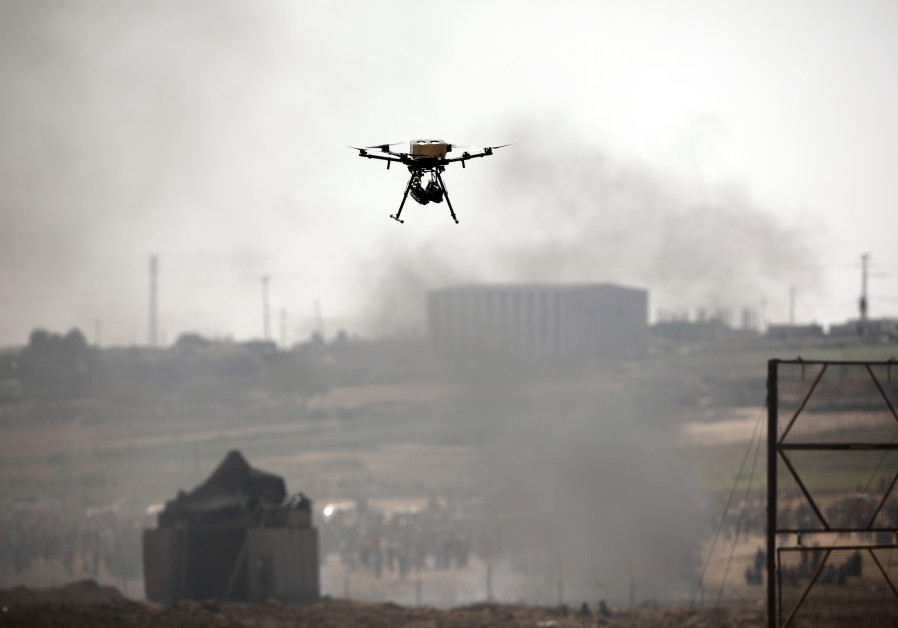 A drone is seen over the border between Israel and Gaza in June