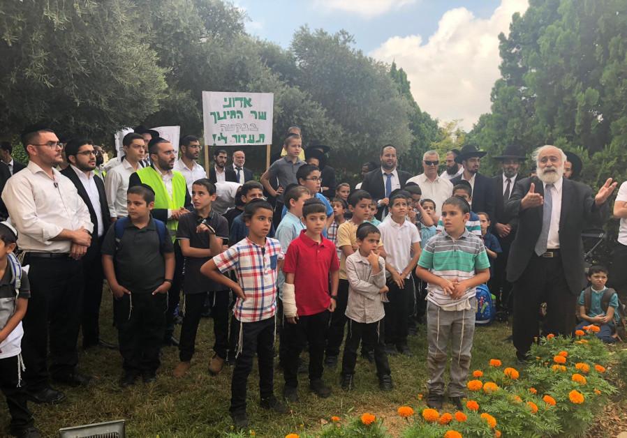Haredim (ultra-Orthodox) residents protest as Avigdor Liberman speaks in Ma'aleh Adumim