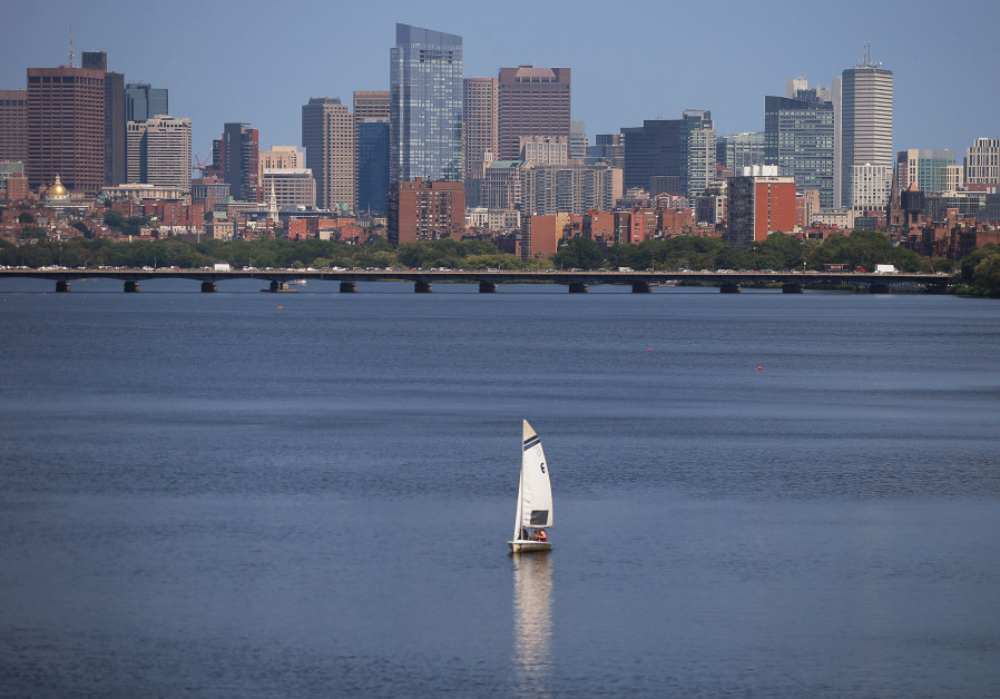 the Charles River in front of the skyline of Boston