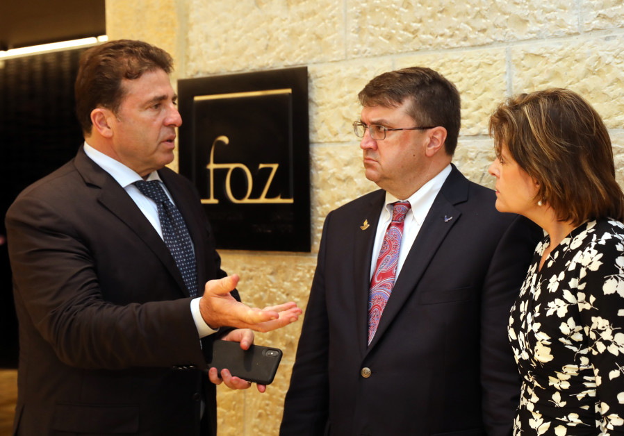 Dr. Rami Levi (Left) welcoming VA Secretary Wilkie (Center) and his wife, Julia (Left), to FOZ