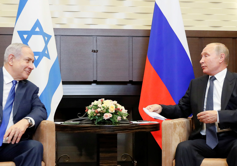 Russian President Vladimir Putin attends a meeting with Israeli Prime Minister Benjamin Netanyahu at