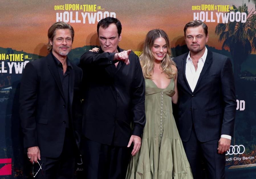 Director Quentin Tarantino and cast members Brad Pitt, Leonardio di Caprio and Margot Robbie pose as
