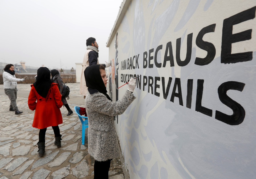 Street-artists in Kabul decorate blast-barricades with colorful artwork