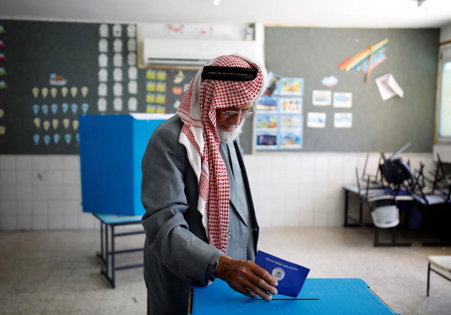 A Bedouin man casts his ballot in Knesset elections on April 9, 2019