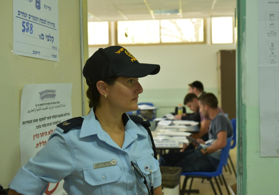 A police officer in a polling station