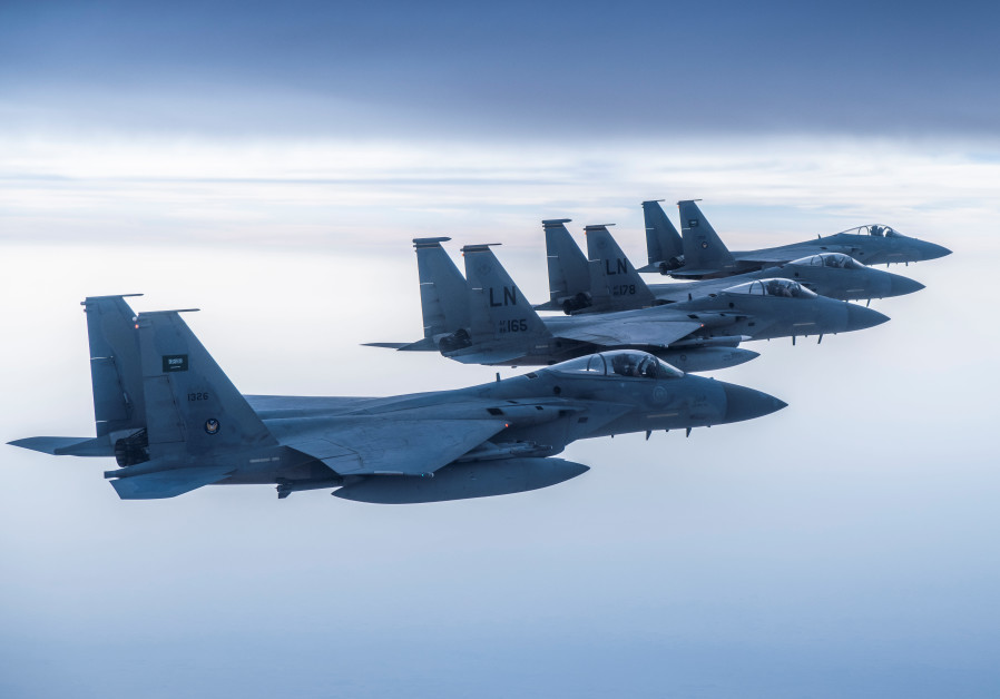 Royal Saudi Air Force F-15's fly with US Air Force F-15's