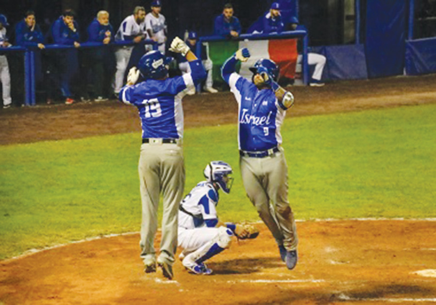 TEAM ISRAEL'S Nick Rickles and Danny Valencia celebrate during their game Friday against Italy.